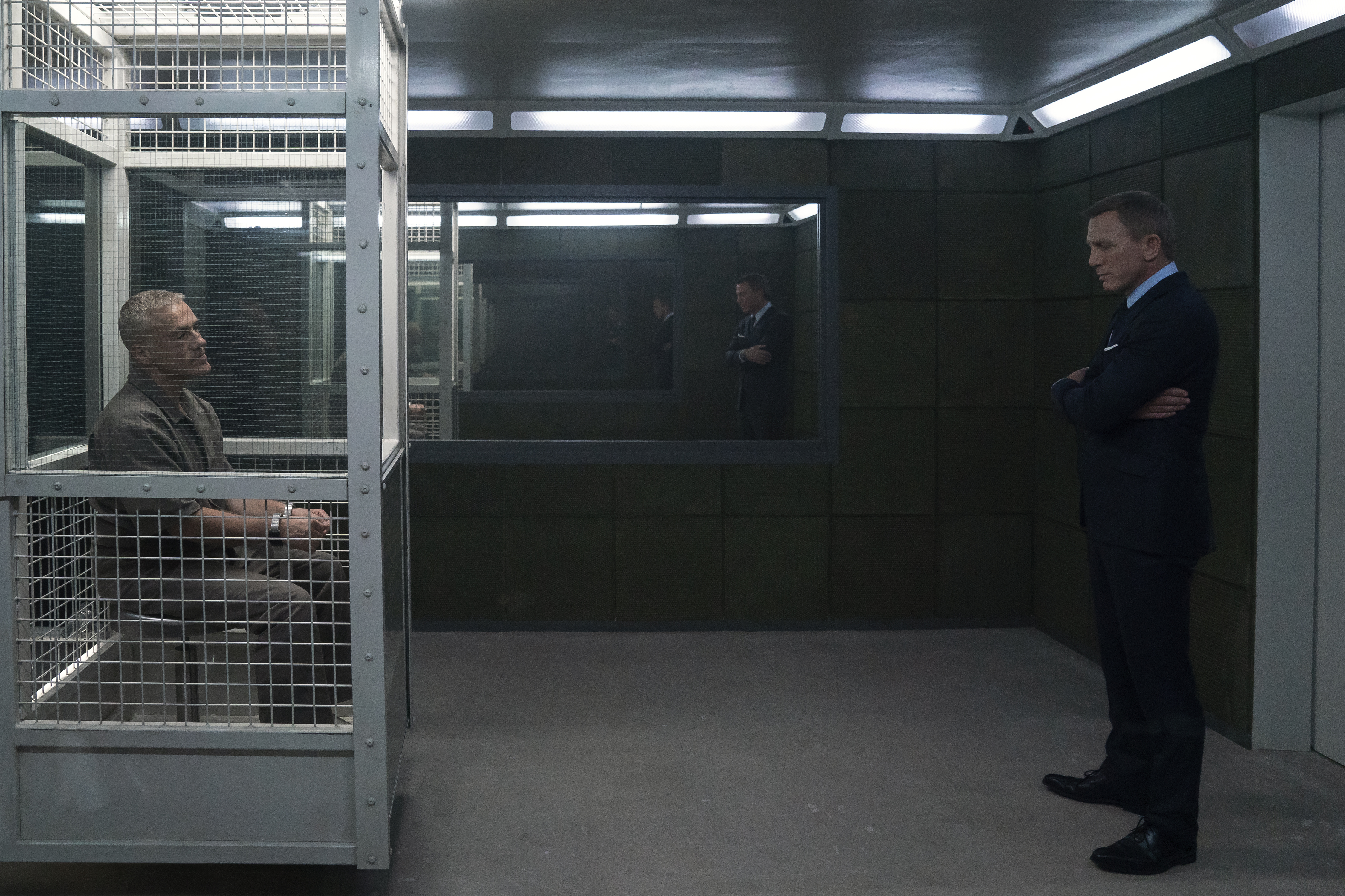 Daniel Craig, as James Bond, visits Blofeld (Christoph Waltz) in his prison cell in No Time to Die